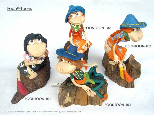 hand-sculpted FoonToon characters sitting on wooden branches and roots, manufacturer, exporter, wholesale supplier directly from Thailand, manufacturer, exporter, wholesale supplier directly from Thailand